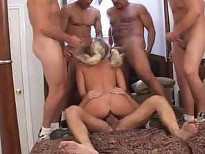 Sandy Haired Babe Enjoys Gangbang And Sucking Dick